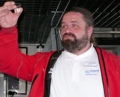 Iceland ProCruises expedition leader gives a musical welcome Ocean Diamond