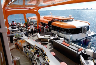 Cruise Trivia: What is the tangerine-colored thing on the side of this ship